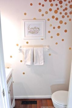Easy Bathroom makeover using gold contact paper!