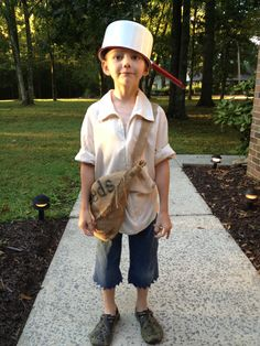 Johnny Appleseed day:) the shirt is one I originally made for a Star Wars costume. Found a blouse at the thrift store and sewed it into a tunic. The seed sack is made from an old potato sack, just cut a bottom corner off and tied on the strap. Pot is an antique, once belonging to my grandmother.