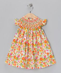 Take a look at this Orange Floral Vanessa Smocked Bishop Dress - Infant & Toddler by Classy Couture on #zulily today!