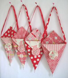 Four little pennant/nosegay Pennie Pockets of Valentine happiness. Fill with treats and love... hang on a front door handle... ring the doorbell... and RUN!  My Pennie Pocket ala Valentine.  My tutorial is available at the Moda Bake Shop.  Tutorial here. Blogged here.
