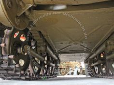The view showing details on the underside of the chassis on a restored Steyr RSO tracked vehicle.