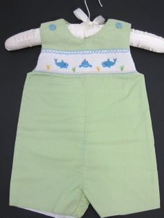 Petit Ami Infant Boy Sunsuit/Shortall with Extensive Shark Smocking Across the Chest on Green, Blue and Yellow Mini-Check Fabric. Buttons at Shoulders and at Back. Cute! Available in Sizes 12, 18 and 24 Months. See Matching Sister Outfit in Toddler Girl (Dolphins