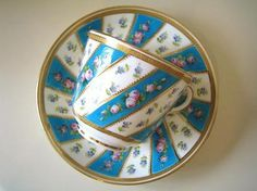 Minton Blue and White Teacup and Saucer edged with gold