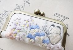 Vintage Purse with butterflies and flowers stitching.
