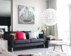 Ikea Karlstad sofa with prettypegs legs and Ikea PS Maskros pendant lamp in Femke Dekker's home via decor8