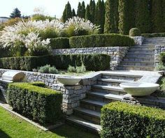 In this article we will discuss how to design a strictly formal garden on a large, rectangular area. Designing formal garden needs a little . Landscaping A Slope, Landscaping Retaining Walls, Landscaping Ideas, Garden Retaining Wall, Stone Retaining Wall, Patio Ideas, Formal Garden Design, Rose Garden Design, Sloped Garden
