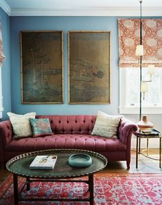 Fantastic color combo light blue walls and raspberry sofa. From www.fromtherightbank.com