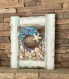 """22""""x 18"""" Beach Glass Wall and/or Window Art/Sea Shell Art/Resin Art/Unique Coastal Decor/Beach House Decor/Great Christmas/Housewarming Gift  Handmade in South Carolina with high quality materials ( seashells, crushed shells, crushed glass, sand pebbles, starfish) and secured with care. The design Nautical Wall Art, Coastal Wall Art, Beach Wall Art, Coastal Decor, Seashell Art, Seashell Crafts, Starfish, Crushed Glass, Sea Glass Art"""