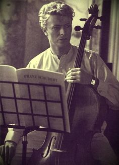 David Bowie, 1983>>YES! A FAMOUS CELLO PLAYER!!! AND HE DOESN'T ONLY DO CELLO GUYS MY LIFE ID CONPLETE