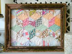 Great for an old quilt that's in bad shape. Frame several cuts from it and share with others in the family!