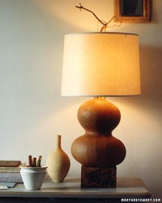 Feeling creative? Create a gourd lamp to decorate your bedroom for the fall season.