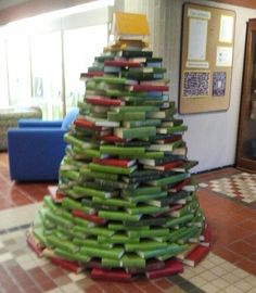 Green- and red-bound books: the coolest library christmas tree everrrr!