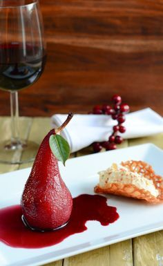 Pears poached in a spicy red wine sauce and served with a white chocolate cream and brandy snap tuiles make an elegant and very tasty dessert.