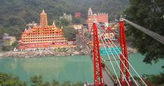 rishikesh_viewAcross the pious #river #Ganges, #Lakshman Jhula is an iron suspension bridge and a famous attraction in the #city of #Rishikesh, #Uttarakhand.