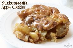 Snickerdoodle Apple Cobbler combines 2 desserts into one! Cinnamon apple pie filling is baked inside snickerdoodle cookie dough & topped with caramel.