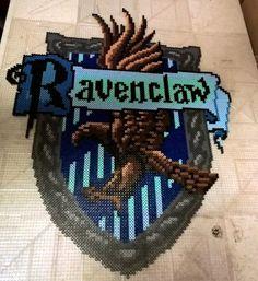 Ravenclaw Crest - Harry Potter perler beads by AesynneZephyrstorm Perler Bead Templates, Pearler Bead Patterns, Perler Patterns, Pixel Art, Harry Potter Perler Beads, Harry Potter Activities, Peler Beads, Iron Beads, Melting Beads