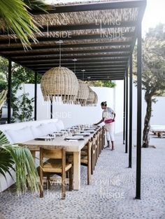 Likes: this is one of the very bet outside dining areas we have seen: cushioned bench on one side, chairs on the other. beautiful rustic table, great lamps, nice refined pergola. Perfect feeling!!
