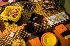 Construction Party uses black, yellow, orange plates & napkins