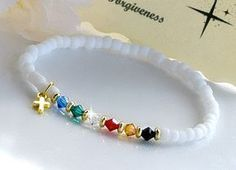 Cute stretchable, swarovski crystal salvation bracelet. Made with 4mm swarovski crystals, white matte beads, and a cute little gold plated cross. Green- Promise of eternal life Blue- Gifts of the Spirit Gold- Heavens with streets of Gold Red- The blood of Christ Black- Sin Clear- Forgiveness