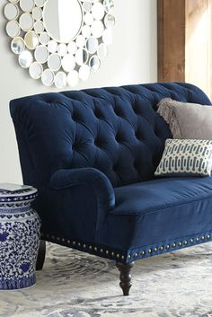 Now that's what we call estately. And you will, too, once you've seen what Pier 1's handcrafted Chas Loveseat can do for your decor. Carved hardwood legs, button-tufted velvet upholstery and handsome, hand-finished nailhead trim make it an instant classic—all without squandering the estate.