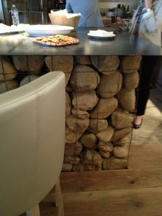 rebar holding stacked rocks - outdoor kitchen?