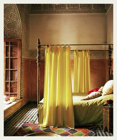 Dreamy bedroom haven almost unattainable with wonderful brass four-poster and the marvelous Indian ancient height ceilings - talk about architecture! Love the bright diamond tiled floor bright rug and the curtains around bed. Very atmospheric