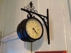 Two sided station clock