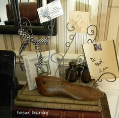 a vintage shoe form becomes a shoe tree... so cute!! By Forever Decorating