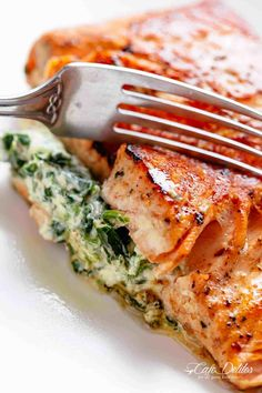 Creamy Spinach Stuffed Salmon in garlic butter is a new delicious way to enjoy salmon! Filled with cream cheese spinach parmesan cheese and garlic this salmon beats than anything found in a restaurant. Your new favourite salmon recipe includes pan frie Baked Salmon Recipes, Fish Recipes, Seafood Recipes, Cooking Recipes, Healthy Recipes, Oven Baked Salmon, Garlic Recipes, Salmon Recipe With Spinach, Recipes Dinner