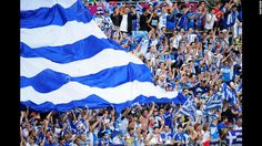 A fan cheers during the Greece-Czech Republic match Tuesday at the Municipal Stadium in Wroclaw. CNN.com