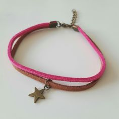 Handmade brown and pink suede bracelet with a bronze star charm. #pink #brown #suede #bronze #star #charm #friendship #bracelet #simple #elegant #cute #depop #handmade #summer #ireland #irish