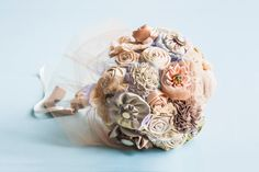 I think these types of bouquets are really cool, you could save them forever. Brooch bouquet
