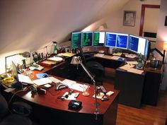 The Boston office of Mitch Haile is a great introduction to the world of seriously overpowered home offices. Haile, a software developer, built his workspace around a U-shaped desk in the attic of his house. As he's often working 60-80 hours a week writing code, it's imperative that his computer area be as ergonomic and comfortable as possible