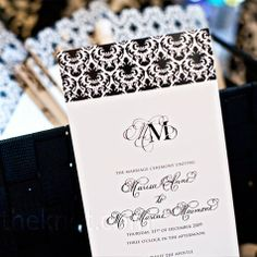 Since she was a child, Marisa knew she wanted a black-and-white wedding with lots of sparkle. The planner suggested adding deep red and fuchsia to accent the classic color combo. A New Year's Eve wedding took shape with a damask pattern and tons of crysta...