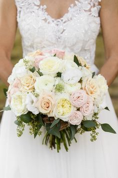 This gorgeous bridal bouquet with a very soft color palette was designed and perfected by our team here at Holliday Events! Photo Credit to: Rob + Deanna Photography
