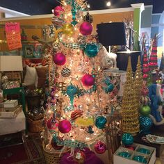 Just loaded up the tree with vintage hot pink and turquoise glass balls from Neiman Marcus. Where it all started me! Shop allChristmas decor at 20% off until I change my mind! #shops@5807