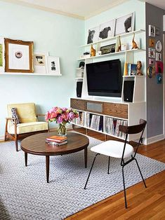Small Studio Apartment Decorating Tips: Use floating wall shelves to store things without cluttering