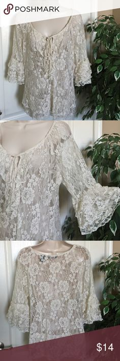"""Frilly Top Ruffles and lace! Creamy good while wearing your choice of colors underneath. A tie at the v-neck allows adjusting. Top is 18"""" long from armpit. Sleeves are 3/4 length. New York & Company Tops"""