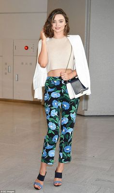 Flower power! Miranda Kerr, 34, proved she wasn't able to slip up in the style stakes as she stepped out in a pair of striking patterned pants, arriving at Narita International Airport in Japan on Sunday