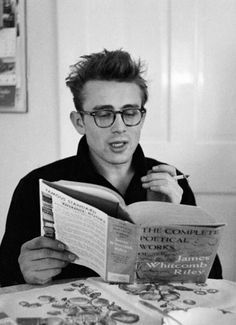 "James reading ""The Complete Poetical Works of James Whitcomb Riley"" Photographed by Dennis Stock, 1955."