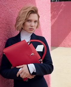 The Spirit of Travel by Louis Vuitton featuring Léa Seydoux with the red soft leather Capucines handbag. Photographed by Patrick Demarchelier.