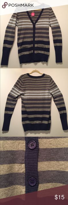 Poof! Shades of Blue Striped Sweater NWT Poof! blue and grey striped sweater. Several different shades of blue. Pocket on either side and a deep V-neck. Bottom of sleeves and bottom of sweater are fitted. Blue buttons down the front. Material is soft and of high quality. Never worn and still has tags. NWT Poof! Sweaters V-Necks