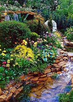 Love the stream in this pretty yard