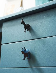 "DIY idea du jour:   Repurpose kids' toy animals as knobs on drawers or cabinet doors.   For a ""before"" look at this particular desk, click through to Design*Sponge here.    See also: Wooden alphabet blocks and wine corks used as knobs, and pieces of worn leather belts used as drawer pulls.  What clever/unusual/quirky things would you do (or have you done) in giving old furniture a makeover?"