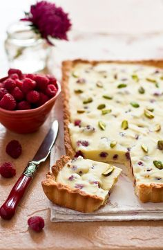 Summer tart with raspberries, white chocolate  pistachios.  The original pin was to a website in Russian (where this picture is from).  I found a close approximation on Food.com