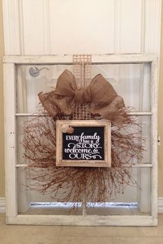 Wreath & frame on old window
