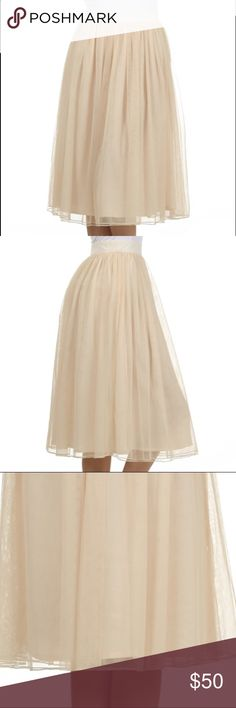 LAST ONE Tulle Skirt Cream Midi Ballet Inspired Gorgeous tulle Midi skirt in cream. So classy and beautiful, this skirt is fully lined and super comfy. Zipper at back of waist. Solid waistband. Sizing is like juniors sizing, Large fits like an 8, in my opinion. I'm happy to provide measurements and other info, just ask! Goes perfectly with a black sweater and heels. Skirts Midi