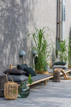 Daybed Beddo designed by Chris Liljenberg Halstrøm for Skagerak.  Simple and cool daybeds on the terrace creates a cosy atmosphere. To get a zen mood, stones and lanterns are placed near the daybeds, which turn on when darkness falls on.
