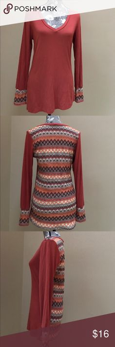 "BKE Top with Pattern on Back BKE burnt orange top with cool pattern on the back and cuffs size XL.  Excellent condition.  95% rayon and 5% spandex.  18"" from underarm to underarm and 28"" long.  Super cute! BKE Tops"