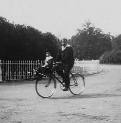 Tsarevich Alexei with his sailor nanny on a very handy bike
